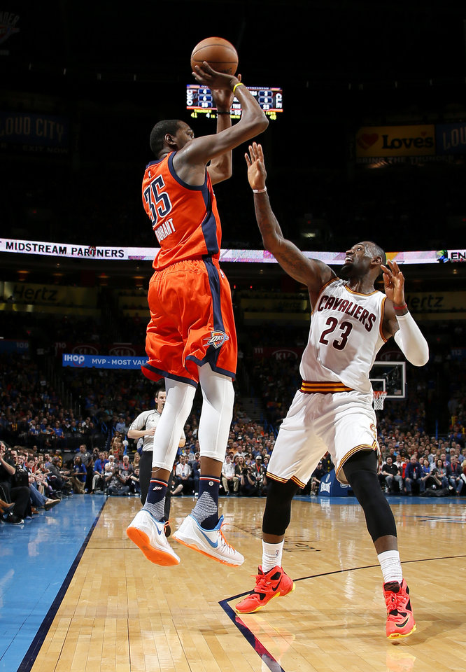 Photo - Oklahoma City's Kevin Durant (35) shoots over Cleveland's LeBron James (23) during an NBA basketball game between the Oklahoma City Thunder and the Cleveland Cavaliers at Chesapeake Energy Arena in Oklahoma City, Sunday, Feb. 21, 2016. Photo by Bryan Terry, The Oklahoman