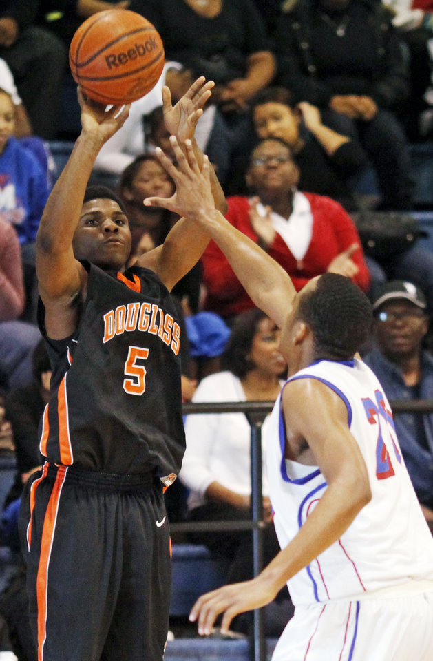 Photo - Stephen Clark (5) of Douglass takes a shot over Drelan Triplett (20) of Millwood during the boys high school basketball game between Douglass and Millwood at the Millwood Field House in Oklahoma City, Saturday, February 5, 2011. Douglass won, 66-64. Photo by Nate Billings, The Oklahoman ORG XMIT: KOD