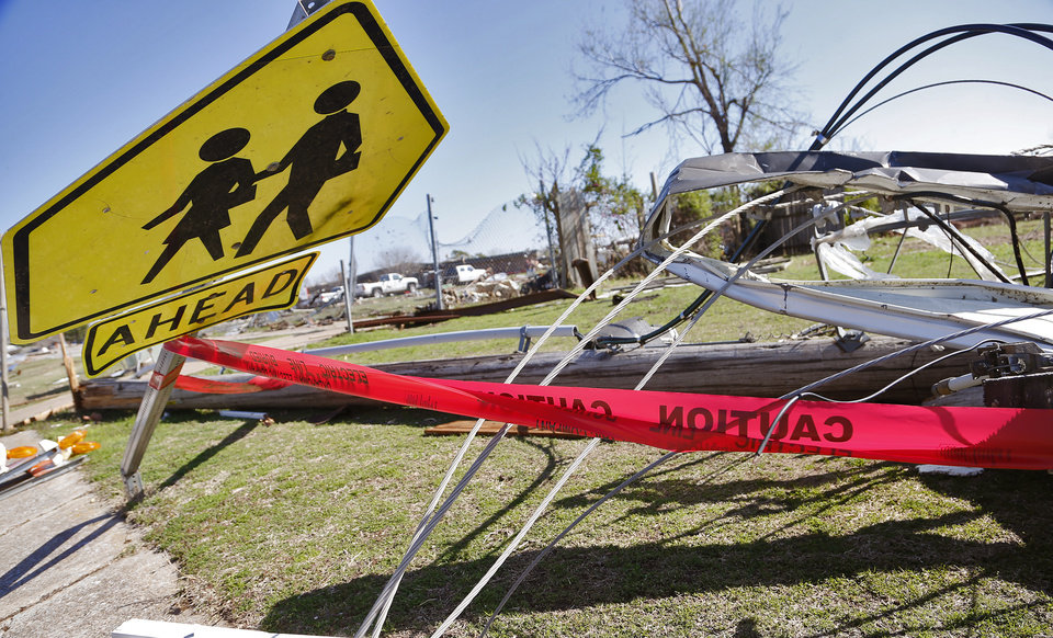 Photo - Caution tape marks off areas of downed power lines Moore, Okla. on Thursday, March 26, 2015. A tornado hit the area on Wednesday evening causing damage in the area.  Photo by Chris Landsberger, The Oklahoman
