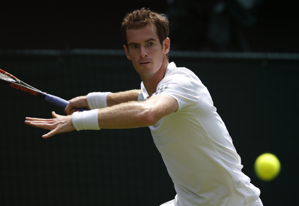 Photo - Andy Murray of Britain plays a return to David Goffin of Belgium during their first round match at the All England Lawn Tennis Championships in Wimbledon, London,  Monday, June  23, 2014. (AP Photo/Pavel Golovkin)