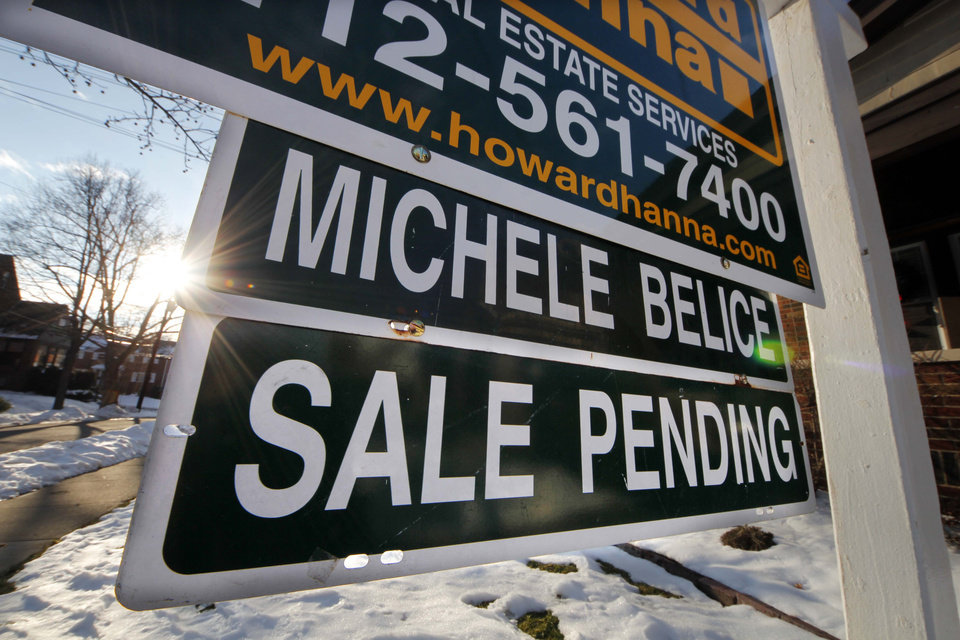 In this Saturday, Jan. 5, 2013, photo, a sale pending is outside a home in Mount Lebanon, Pa. After years in the doldrums, the housing market appears back on track. Home sales and prices are up, and mortgage rates remain near historic lows, reinvigorating the appeal of homeownership. But qualifying for a home loan remains a hurdle for anyone without a solid personal balance sheet. (AP Photo/Gene J. Puskar)