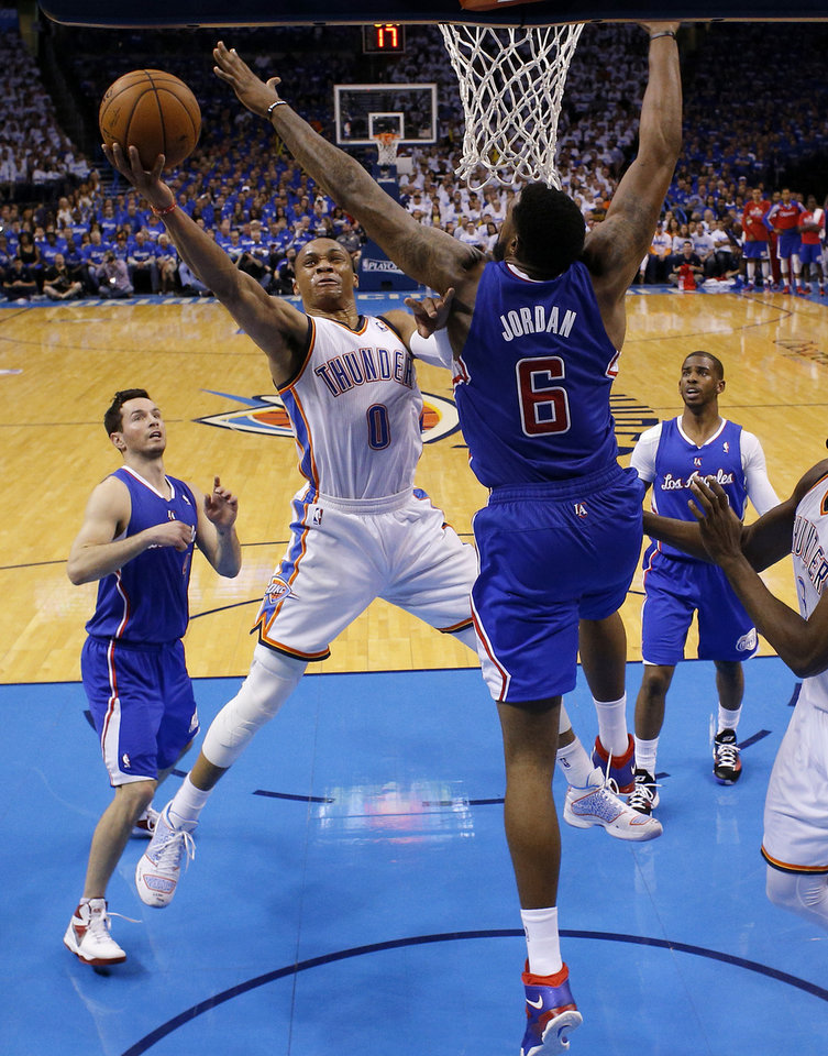 Photo - Oklahoma City's Russell Westbrook (0) goes to the basket between Los Angeles' J.J. Redick (4), DeAndre Jordan (6), and Chris Paul (3) during Game 2 of the Western Conference semifinals in the NBA playoffs between the Oklahoma City Thunder and the Los Angeles Clippers at Chesapeake Energy Arena in Oklahoma City, Wednesday, May 7, 2014. Photo by Bryan Terry, The Oklahoman