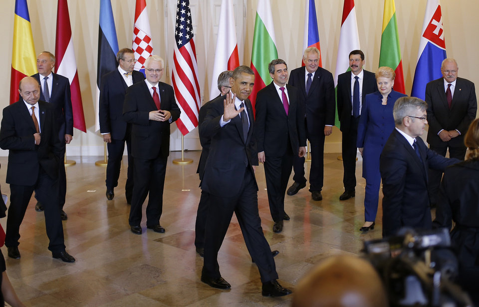 Photo - President Barack Obama and Polish President Bronislaw Komorowski walk away after a group photo with Central and Eastern European Leaders in Warsaw, Poland, Tuesday, June 3, 2014. From left are: Romania President Traian Basescu; Latvia President Andris Berzins; Estonia President Toomas Hendrik Ilves; Croatia's President Ivo Josipovic; President Obama; President Komorowski; Bulgaria President Rosen Plevneliev; Czech Republic President Milos Zeman; Hungary President Janos Ader; Lithuania President Dalia Grybauskaite; Slovakia President Ivan Gasparovic. (AP Photo/Charles Dharapak)