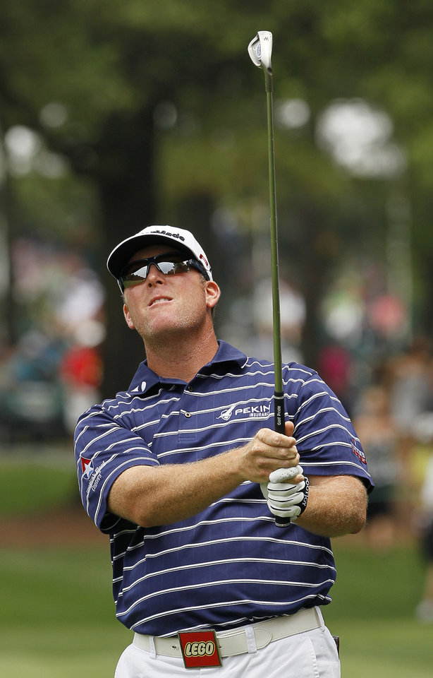 Photo -   D.A. Points watches a shot from the first fairway during the third round of the Wells Fargo Championship golf tournament at Quail Hollow Club in Charlotte, N.C., Saturday, May 5, 2012. (AP Photo/Gerry Broome)