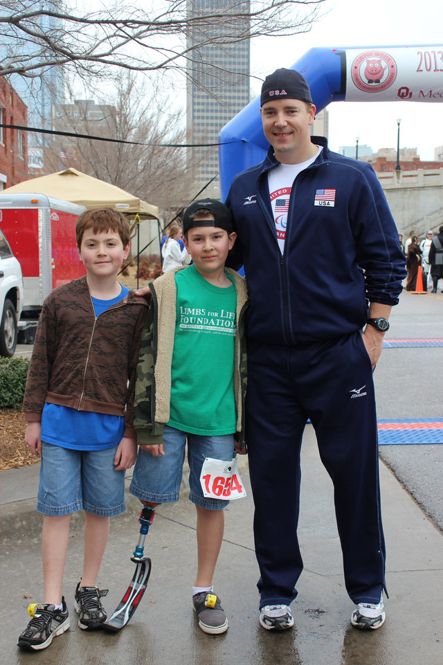 Right: Ryan Karrow, Connor Karrow and Charlie Swearingen are seen at the Hog Jog 5k. PHOTOS BY KRISTA BRUCE,  FOR THE OKLAHOMAN