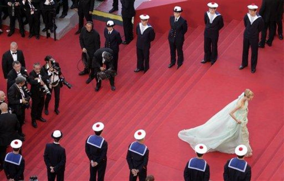 Photo - Jury member Diane Kruger, right, walks up the steps of the red carpet during the opening ceremony and screening of Moonrise Kingdom at the 65th international film festival, in Cannes, southern France, Wednesday, May 16, 2012. Kruger is wearing a dress by Versus. (AP Photo/Virginia Mayo, Pool)
