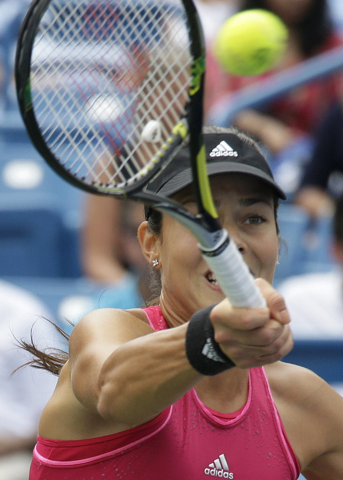 Photo - Ana Ivanovic, from Serbia, volleys against Serena Williams during a final match at the Western & Southern Open tennis tournament, Sunday, Aug. 17, 2014, in Mason, Ohio. Williams won 6-4, 6-1. (AP Photo/Al Behrman)