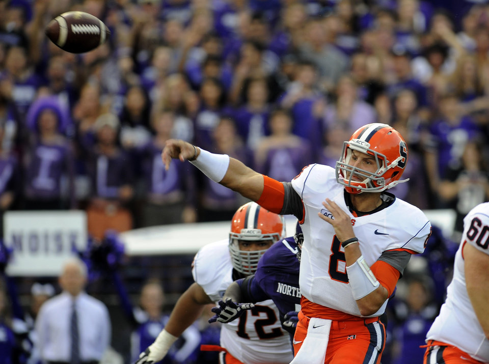Syracuse's Drew Allen (8) throws during the first half of an NCAA college football game Saturday, Sept. 7, 2013 in Evanston, Ill. (AP Photo/Matt Marton)