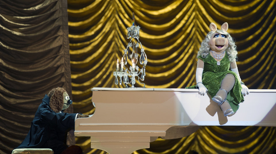 """Photo -  This image released by Disney shows Rowlf, left, and Miss Piggy in a scene from """"Muppets Most Wanted."""" AP Photo/Disney, Jay Maidment   Jay Maidment -"""