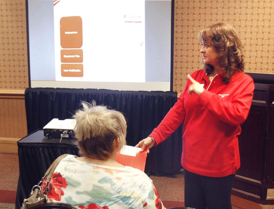 Loan Specialist Mayra Gilmore conducts a seminar as Bank of America holds a homeowners' assistance event at the Cox Convention Center in Oklahoma City, OK, Thursday, July 26, 2012. Customers can come in for guidance about mortgage refinancing, short sales and other options.  By Paul Hellstern, The Oklahoman