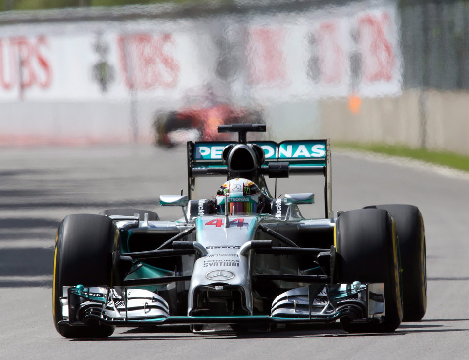 Photo - Mercedes driver Lewis Hamilton from Great Britain takes part in the first free practice session at Circuit Gilles Villeneuve Friday, June 6, 2014, in Montreal. The Canadian Grand Prix will be held Sunday, June 8, 2014. (AP Photo/The Canadian Press, Tom Boland)