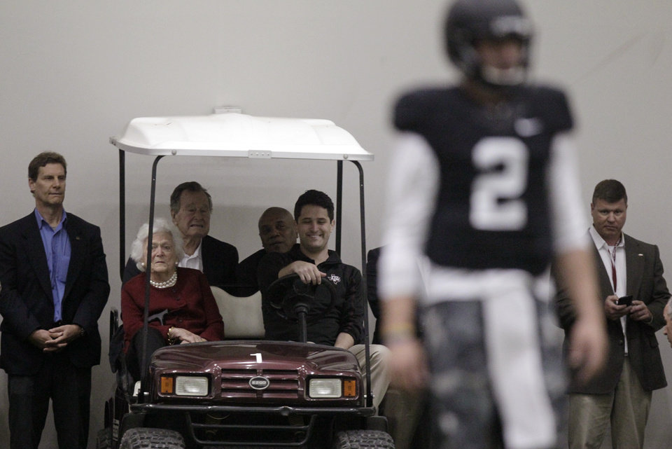 Photo - Former President George H.W. Bush and Barbara Bush, watch Texas A&M quarterback Johnny Manziel (2) during pro day for NFL football representatives in College Station, Texas, Thursday, March 27, 2014. (AP Photo/Patric Schneider)