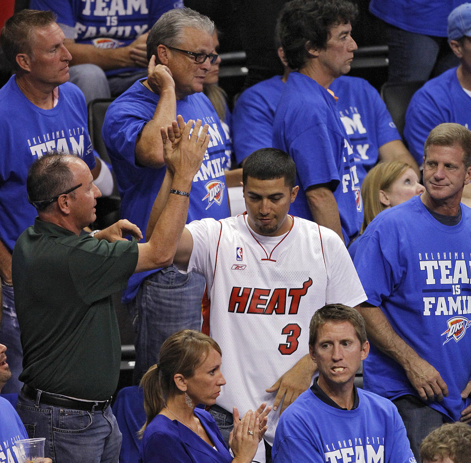 Photo - Heat fans celebrate in the stands during Game 2 of the NBA Finals between the Oklahoma City Thunder and the Miami Heat at Chesapeake Energy Arena in Oklahoma City, Thursday, June 14, 2012. Photo by Chris Landsberger, The Oklahoman
