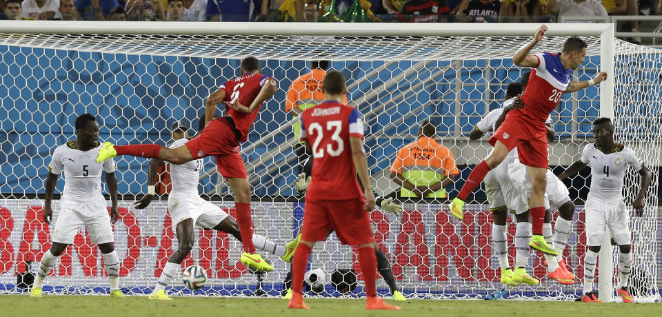Photo - United States' John Brooks, No 6 centre, scores his side's second goal during the group G World Cup soccer match between Ghana and the United States at the Arena das Dunas in Natal, Brazil, Monday, June 16, 2014.  (AP Photo/Ricardo Mazalan)