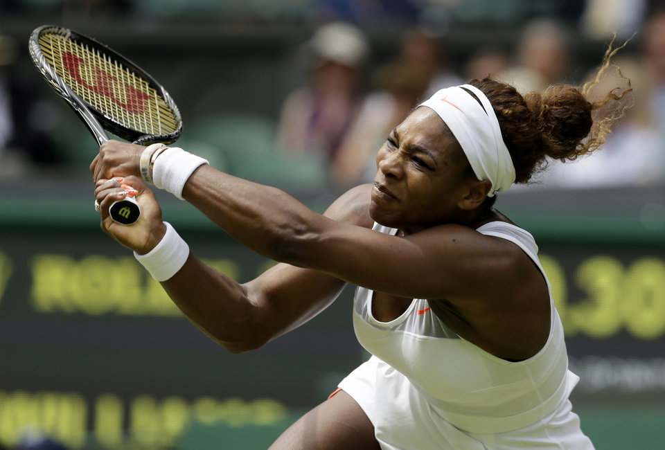 Photo - ADVANCE FOR WEEKEND EDITIONS, JUNE 21-22 - FILE - In this July 1, 2013, file photo, Serena Williams, of the United States, returns to Sabine Lisicki, of Germany, during a women's singles match at the All England Lawn Tennis Championships in Wimbledon, London (AP Photo/Alastair Grant, File)