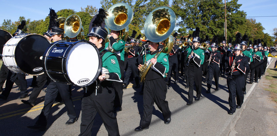 Photo - Norman High School and Norman North High School bands march together in the Veterans Day Parade in Norman Friday, Nov. 11, 2011. Photo by Paul B. Southerland, The Oklahoman