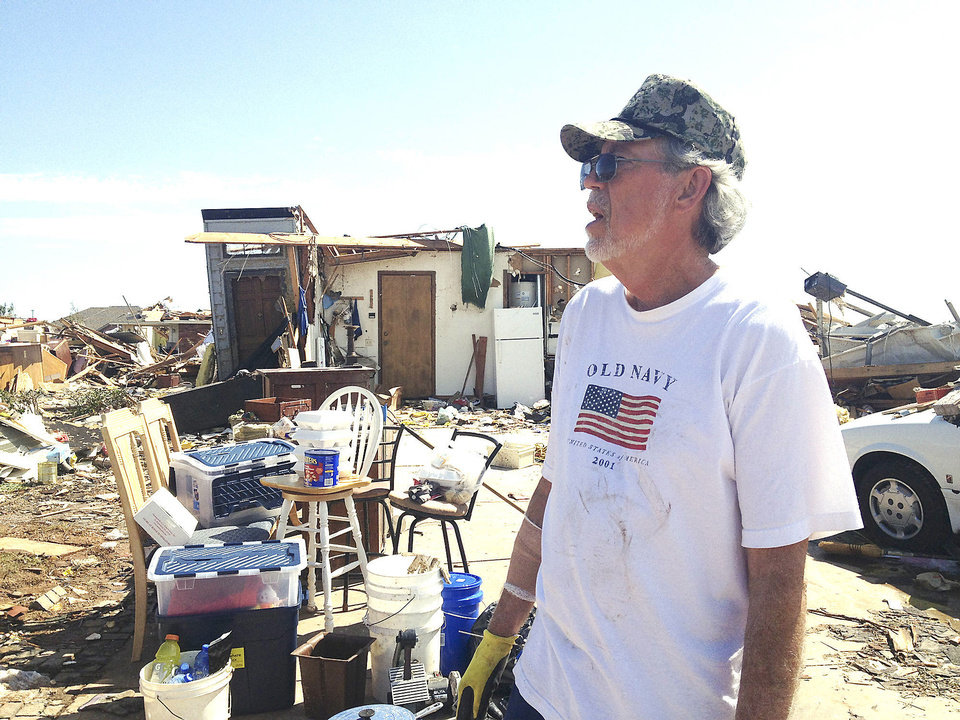 "Tom Bridges' house was destroyed in Moore on Monday, May 20. He put a sign up that said ""Rummage sale-cheap"" to get 'A laugh out of all this mess. We need that,"" the Army veteran, 68, said. <strong></strong>"