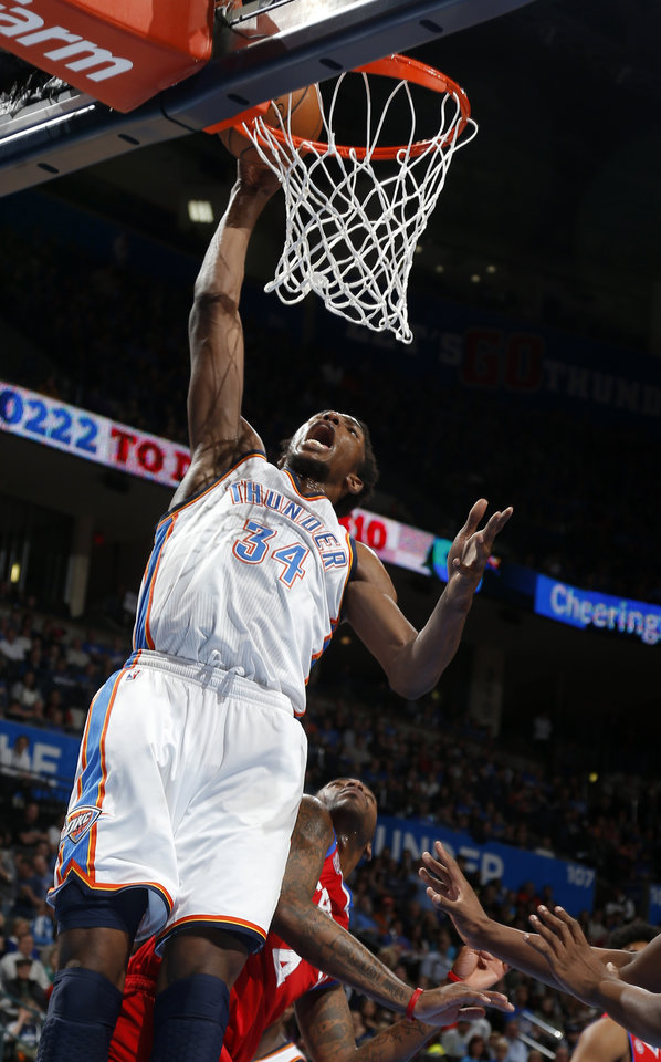 Oklahoma City's Hasheem Thabeet (34) shoots a dunk in front of Philadelphia's Dorell Wright (4) during the NBA game between the Oklahoma City Thunder and the Philadelphia 76ers at the Chesapeake Energy Arena in Oklahoma City, Friday,Jan. 4, 2013. Photo by Sarah Phipps, The Oklahoman