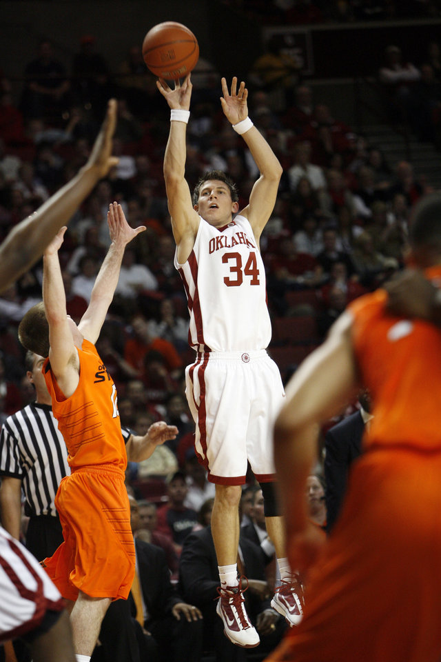 Photo - Cade Davis shoots during the first half of the college bedlam basketball game between The University of Oklahoma Sooners (OU) and Oklahoma State University University Cowboys (OSU) at the Lloyd Noble Center on Monday, Jan. 11, 2010, in Norman, Okla.