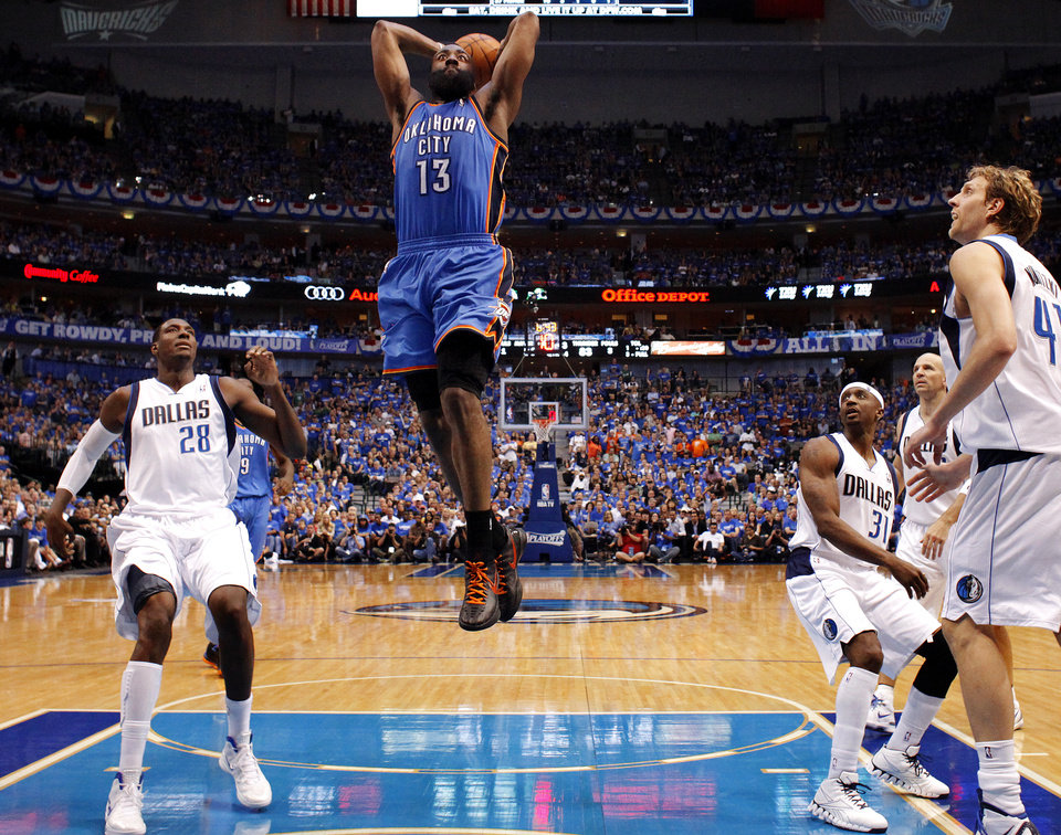 Oklahoma City's James Harden (13) goes up for a dunk beside Dallas' Ian Mahinmi (28) during Game 4 of the first round in the NBA playoffs between the Oklahoma City Thunder and the Dallas Mavericks at American Airlines Center in Dallas, Saturday, May 5, 2012. Oklahoma City won 103-97. Photo by Bryan Terry, The Oklahoman