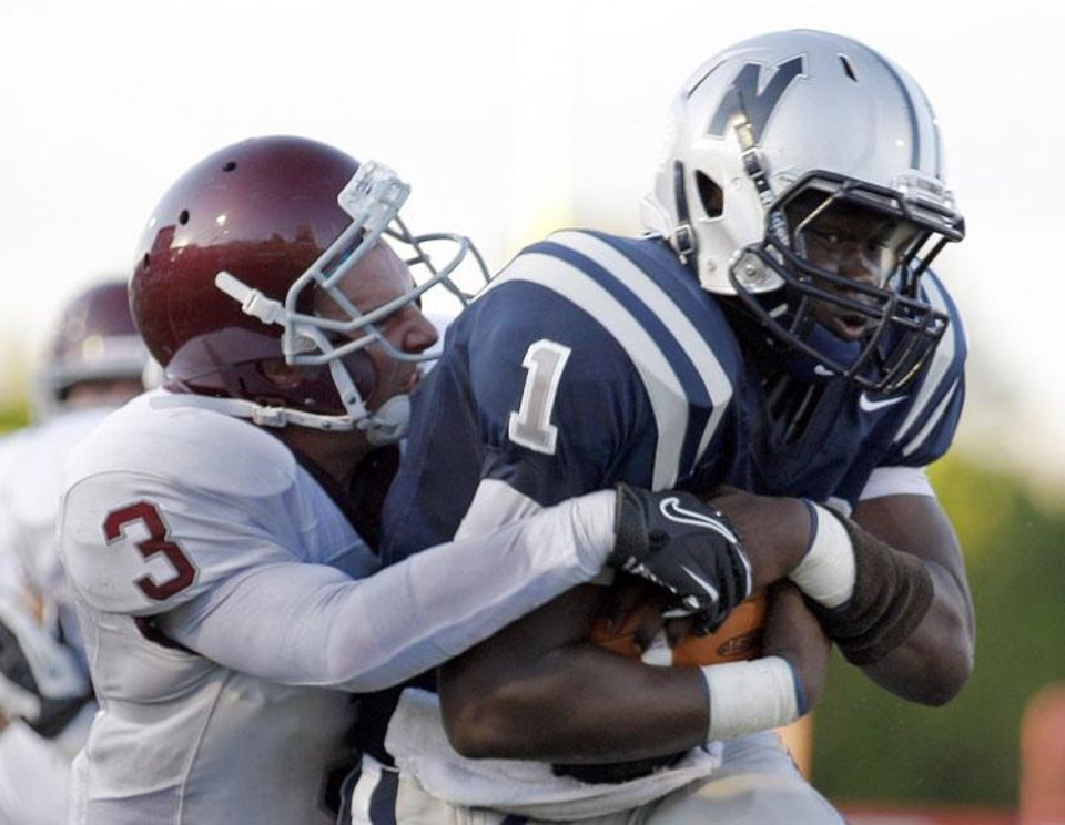 Edmond North\'s Michael Farmer tries to get by Edmond Memorial\'s Sam Kreutzer during the high school football game between Edmond North and Edmond Memorial at Wantland Stadium in Edmond, Okla., Friday, Aug. 31, 2012. Photo by Sarah Phipps, The Oklahoman