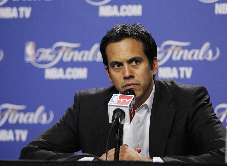 Miami Heat head coach Erik Spoelstra listens to a question during a news conference after Game 4 of the NBA finals basketball series against the Oklahoma City Thunder, Tuesday, June 19, 2012, in Miami. The Miami Heat won 104-98. (AP Photo/Lynne Sladky)  ORG XMIT: NBA178