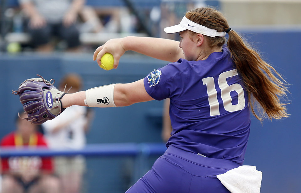 Photo - Washington's Gabbie Plain (16) pitches during the second game of the Women's College World Series between the Oklahoma Sooners (OU) and Washington Huskies at USA Softball Hall of Fame Stadium in Oklahoma City, Thursday, May 31, 2018. Washington won 2-0. Photo by Nate Billings, The Oklahoman