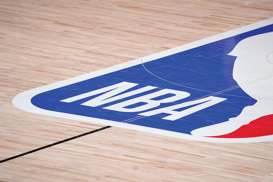 Photo - The NBA logo at center court is shown during the second half of an NBA first-round playoff basketball game between the Houston Rockets and Oklahoma City Thunder in Lake Buena Vista, Fla., Wednesday, Sept. 2, 2020. (AP Photo/Mark J. Terrill)