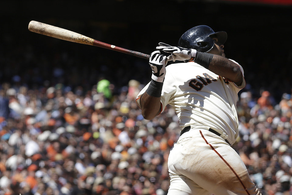 Photo - San Francisco Giants' Pablo Sandoval hits a sacrifice fly to score Hunter Pence during the seventh inning of a baseball game against the Washington Nationals in San Francisco, Thursday, June 12, 2014. (AP Photo/Jeff Chiu)