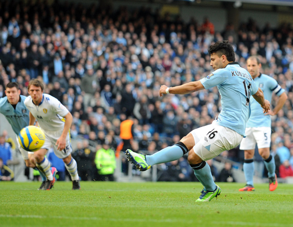 Photo - Manchester City's Sergio Aguero scores the second goal of the game for his side from the penalty spot during their English FA Cup fifth round soccer match against Leeds United at the Etihad Stadium in Manchester, England, Sunday Feb. 17, 2013. (AP Photo/Clint Hughes)