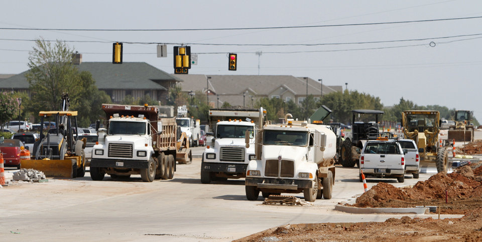 Photo - Construction continues at Covell and Kelly in Edmond,. Photo By Steve Gooch, The Oklahoman  Steve Gooch