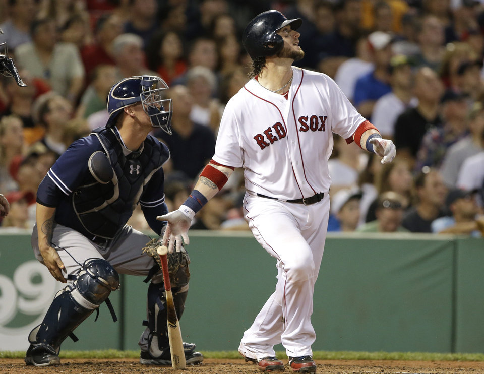 Photo - Boston Red Sox's Jarrod Saltalamacchia watches his RBI double to left, in front of San Diego Padres catcher Yasmani Grandal during the fourth inning of an interleague baseball game at Fenway Park in Boston, Wednesday, July 3, 2013. (AP Photo/Elise Amendola)