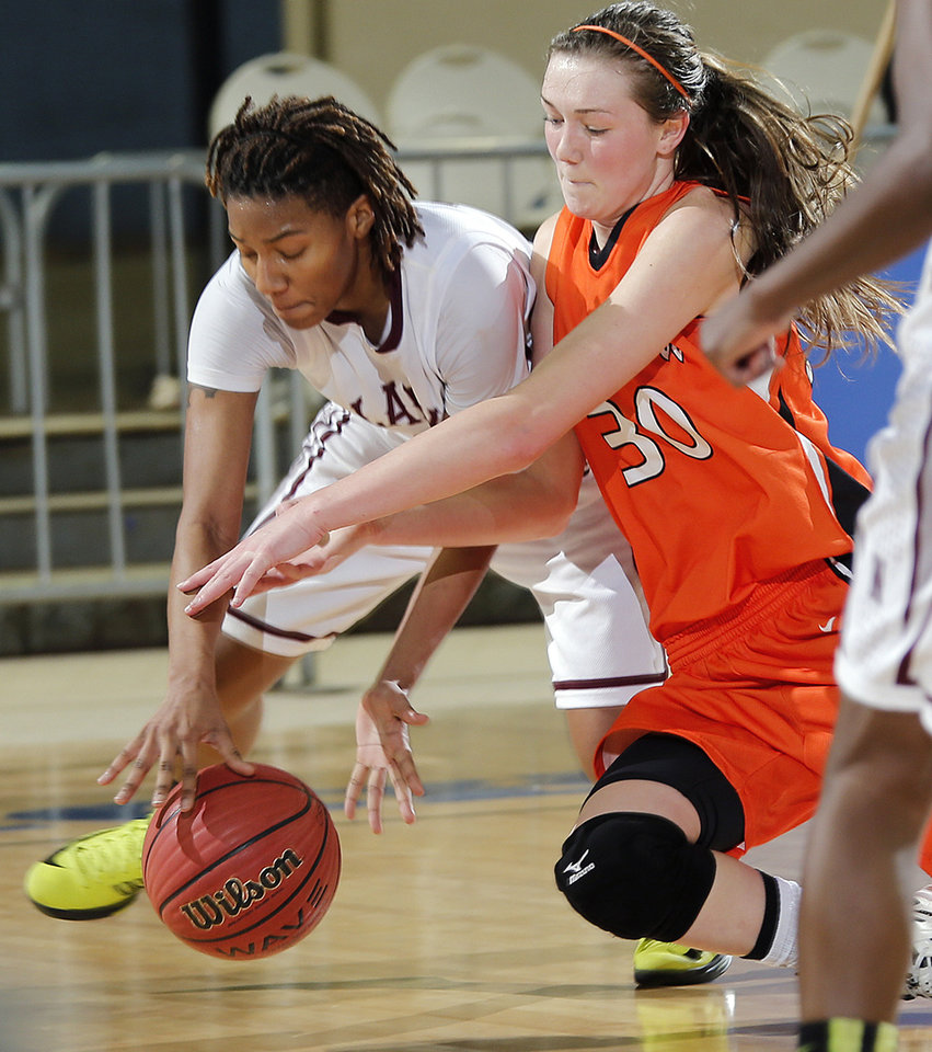 Northeast\'s Danielle Gaddis (11) and Fairview\'s Sadie Mason (30) go after a loose ball during the state high school basketball tournament Class 2A girls semifinal game between Fairview High School and Northeast High School at the State Fair Arena on Friday, March 8, 2013, in Oklahoma City, Okla. Photo by Chris Landsberger, The Oklahoman