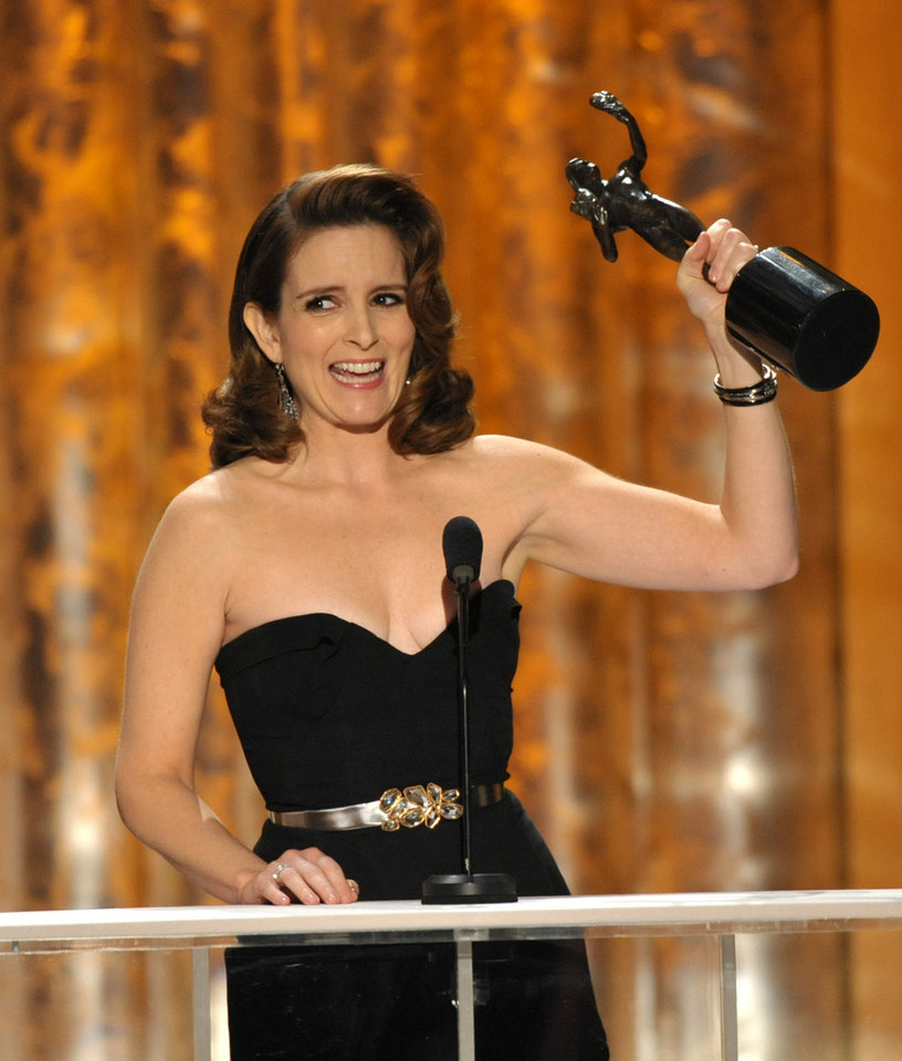 "Photo - Tina Fey accepts the award for outstanding female actor in a comedy series for ""30 Rock"" at the 19th Annual Screen Actors Guild Awards at the Shrine Auditorium in Los Angeles on Sunday Jan. 27, 2013. (Photo by John Shearer/Invision/AP)"