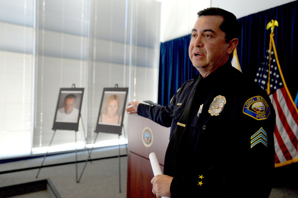 Photo - Sgt. Israel Ramirez with the Long Beach Police Department addresses the media at a news conference Thursday, July 24, 2014, in Long Beach, Calif. Police said they're deciding whether to arrest an 80-year-old man who shot a fleeing, unarmed burglar despite her telling him she was pregnant, but they have arrested the woman's accomplice on suspicion of murder for taking part in a crime that led to her death. (AP Photo/The Press-Telegram, Sean Hiller)