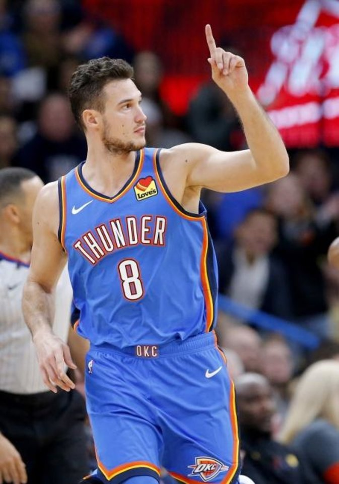 Photo -  Danilo Gallinari, who scored a team-high 19 points, celebrates one of his four made 3-pointers Saturday in the Thunder's 114-108 win against the Warriors.  [Sarah Phipps/The Oklahoman]
