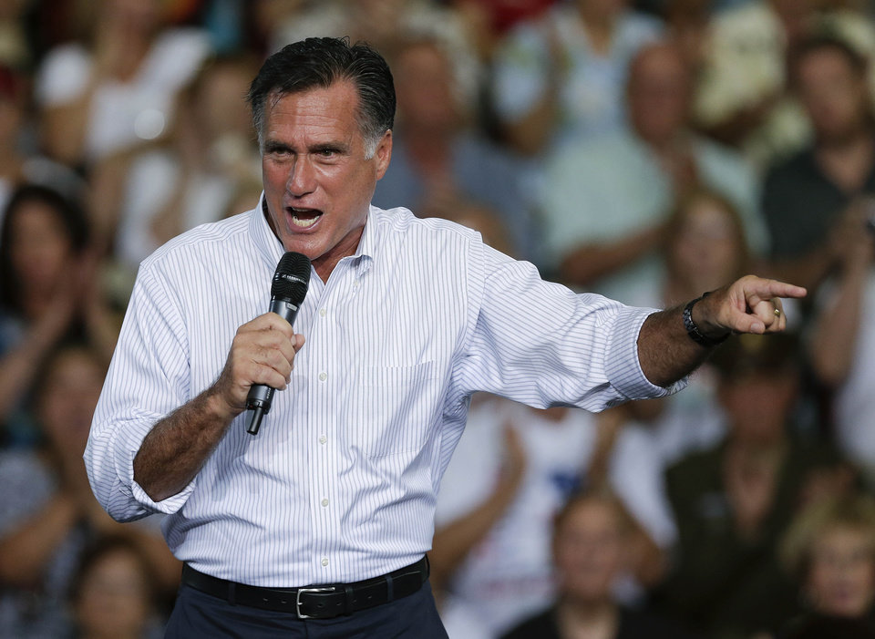 Photo -   Republican presidential candidate and former Massachusetts Gov. Mitt Romney speaks to supporters during a rally Friday, Sept. 21, 2012, in Las Vegas. Romney campaigned in Nevada as aides released a 2011 federal income tax return showing he and his wife, Ann, paid $1.94 million in federal taxes last year on income of $13.7 million. (AP Photo/Julie Jacobson)