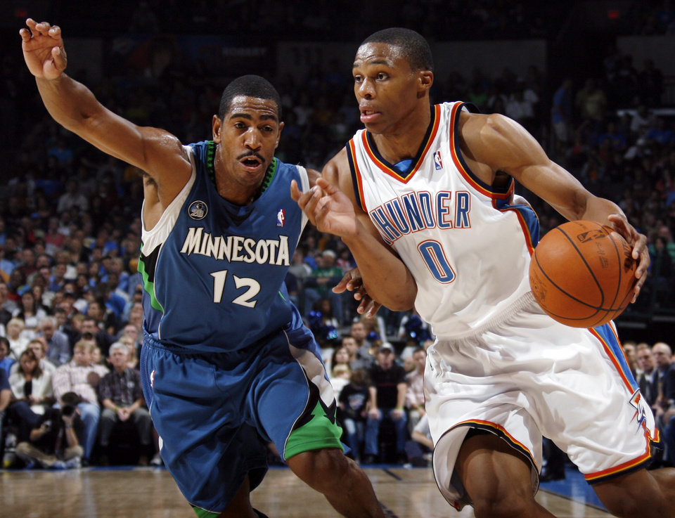 Photo - FIRST REGULAR SEASON WIN: Oklahoma City's Russell Westbrook drives past Kevin Ollie of Minnesota during the NBA basketball game between the Oklahoma City Thunder and the Minnesota Timberwolves at the Ford Center in Oklahoma City, Sunday, Nov. 2, 2008. BY NATE BILLINGS, THE OKLAHOMAN  ORG XMIT: KOD