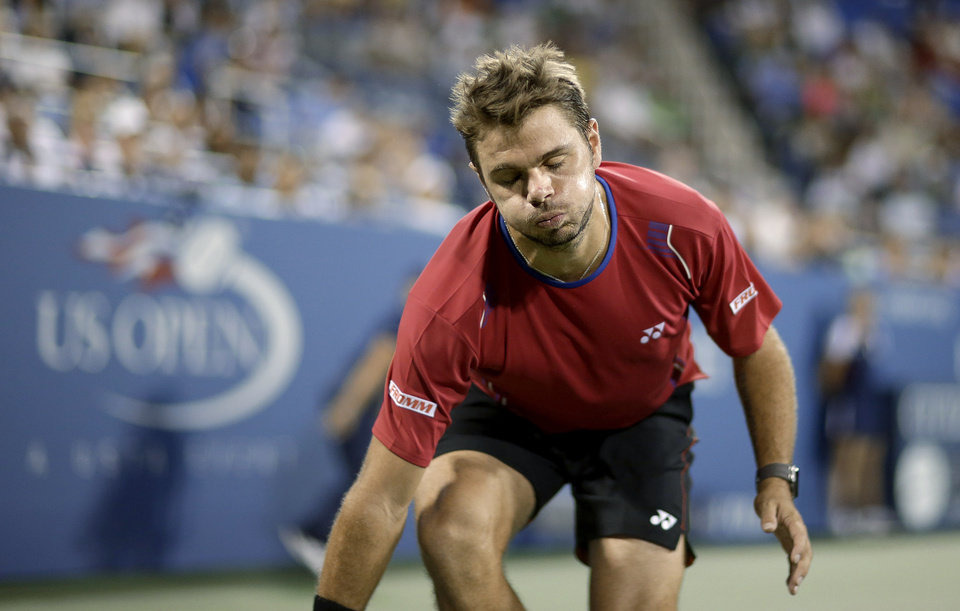 Stanislas Wawrinka, of Switzerland, reacts after an ace by Tomas Berdych, of the Czech Republic, during the fourth round of the U.S. Open tennis tournament, Tuesday, Sept. 3, 2013, in New York. (AP Photo/David Goldman)