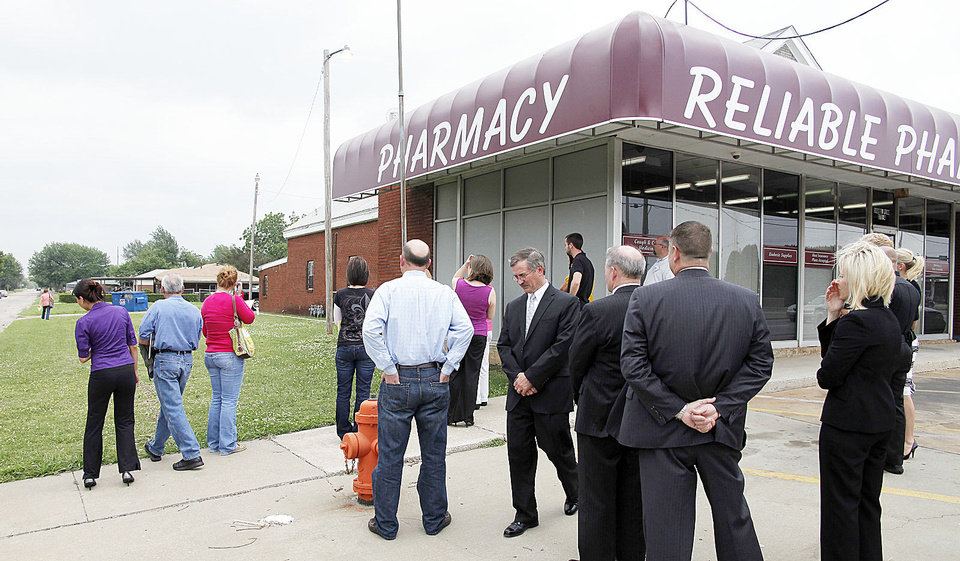 Jurors were taken to Reliable Discount Pharmacy in south Oklahoma City last May during a pharmacist's murder trial. In this archive photo, some jurors check the north side of the store while prosecutors and the judge wait.  PHOTO BY DOUG HOKE, THE OKLAHOMAN ARCHIVES