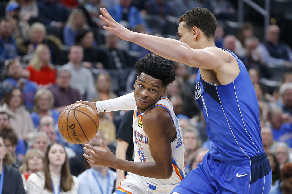 Photo - Oklahoma City's Shai Gilgeous-Alexander (2) goes past Dwight Powell (7) of Dallas during an NBA basketball game between the Oklahoma City Thunder and the Dallas Mavericks at Chesapeake Energy Arena in Oklahoma City, Tuesday, Dec. 31, 2019. Oklahoma City won 106-101. [Bryan Terry/The Oklahoman]