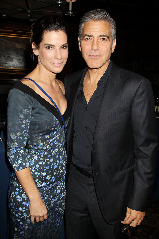 "This image released by Starpix shows Sandra Bullock, left, and George Clooney at luncheon honoring the film ""Gravity,"" and hosted by The Peggy Siegal Company and Warner Brothers Pictures at The Explorers Club, Wednesday, Oct. 2, 2013 in New York. (AP Photo/Starpix, Dave Allocca) -PICTURED: Sandra Bullock and George Clooney    -PHOTO by: Dave Allocca/Startraksphoto.com -File name: DA560447.JPG -Location: The Explorers Club Editorial - Rights Managed Image - Please contact www.startraksphoto.com for licensing fee Startraks Photo New York, NY For licensing please call 212-414-9464 or email sales@startraksphoto.com ORG XMIT: NYET316"