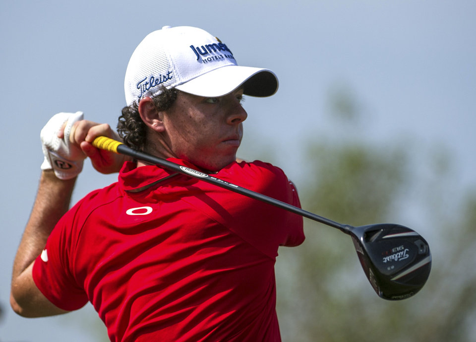 Photo -   Rory McIlroy of Northern Ireland tees off on the 9th hole during the final round of the DP World Golf Championship in Dubai, United Arab Emirates, Sunday, Nov. 25, 2012. (AP Photo/Stephen Hindley)