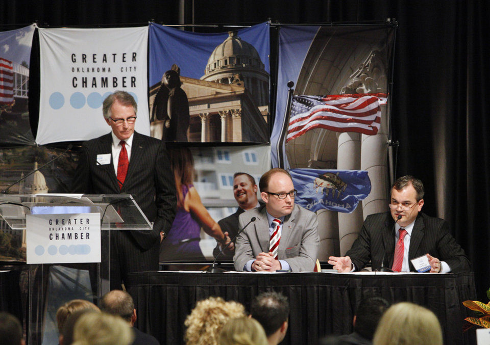 Photo - Panel moderator David Rainbolt, vice chairman of government relations for the Greater Oklahoma City Chamber, and Rep. Scott Inman listen as Sen. Sean Burrage responds to a question during a panel discussion at the 2013 Legislative Breakfast sponsored by the Greater Oklahoma City Chamber in Oklahoma City Thursday, Jan. 31, 2013. Photo by Paul B. Southerland, The Oklahoman