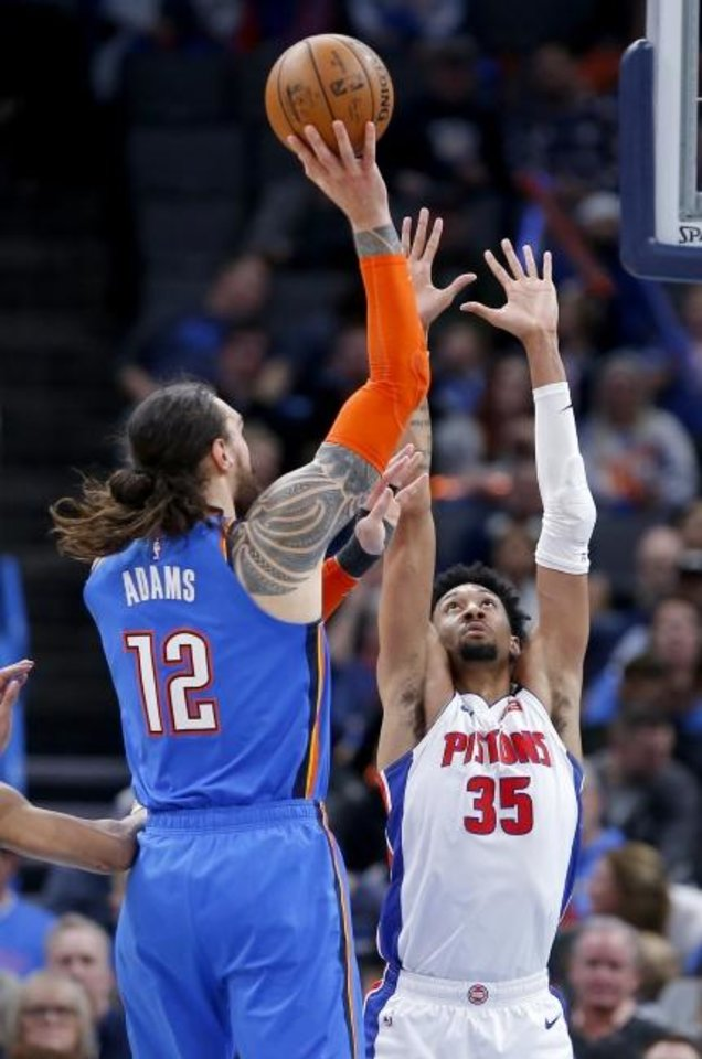 Photo -  Oklahoma City's Steven Adams (12) shoots over Detroit's Christian Wood (35) during the Thunder's 108-101 win Friday at Chesapeake Energy Arena. [Sarah Phipps/The Oklahoman]