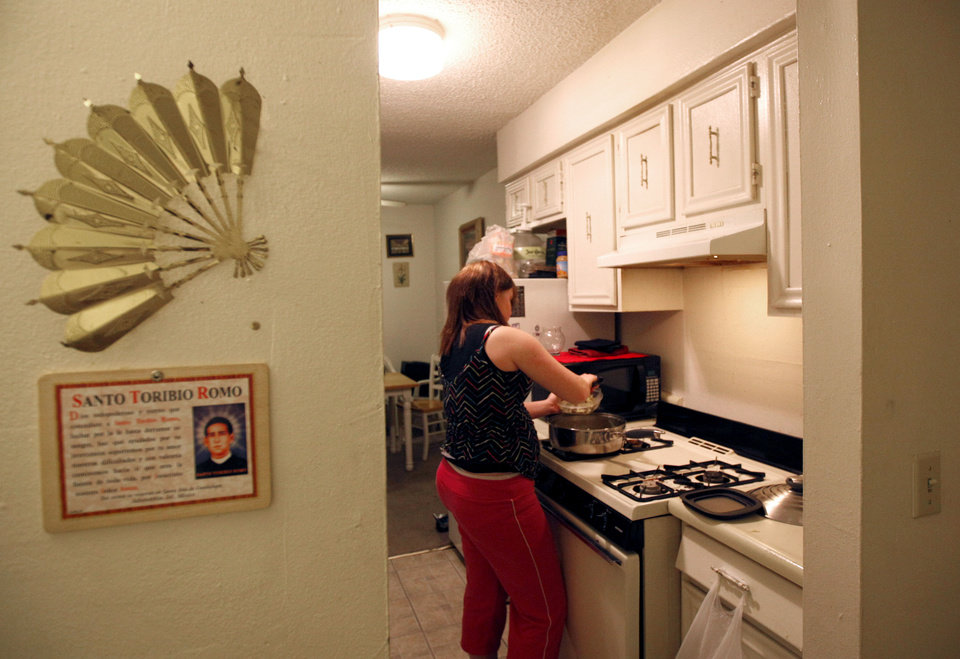 Renae makes dinner at her Oklahoma City home, Thursday, Feb. 9, 2012. Photo by Sarah Phipps, The Oklahoman