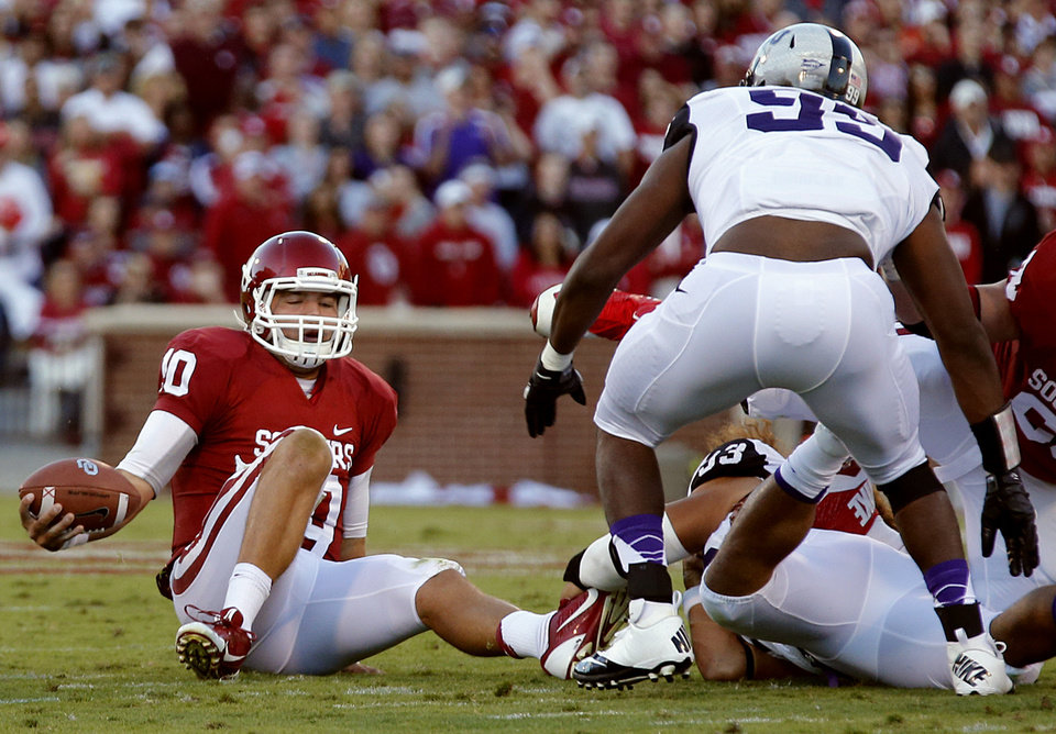 Oklahoma's Blake Bell (10) is sacked by the TCU defense during the college football game between the University of Oklahoma Sooners (OU) and the Texas Christian University Horned Frogs (TCU) at the Gaylord Family-Oklahoma Memorial Stadium on Saturday, Oct. 5, 2013 in Norman, Okla.   Photo by Chris Landsberger, The Oklahoman