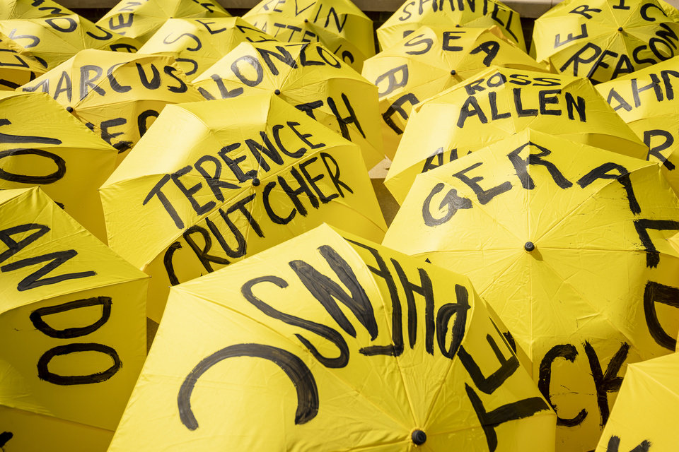 Photo - 6/20/20 5:04:13 PM -- Tulsa, OK, U.S.A  -- Umbrellas bearing the names of 100 people killed by police are seen at a protest in Tulsa, Okla. on Saturday, June 20, 2020 as President Donald Trump visits the city for his first campaign rally since the start of the coronavirus pandemic. --    Photo by Shane Bevel, Freelance