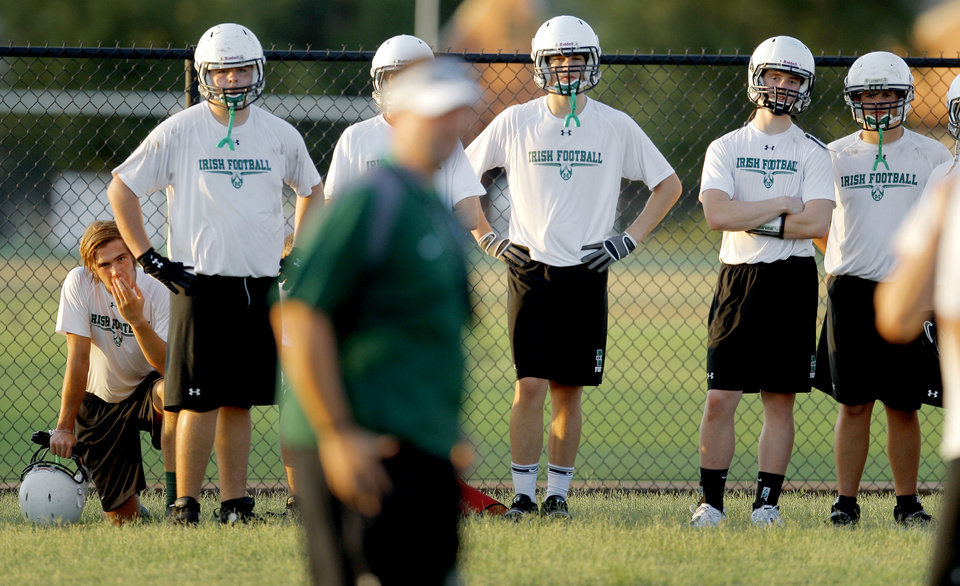 Photo - The Bishop McGuinness football team stands during football practice in Oklahoma City, Wednesday, August 10, 2011. Photo by Bryan Terry, The Oklahoman