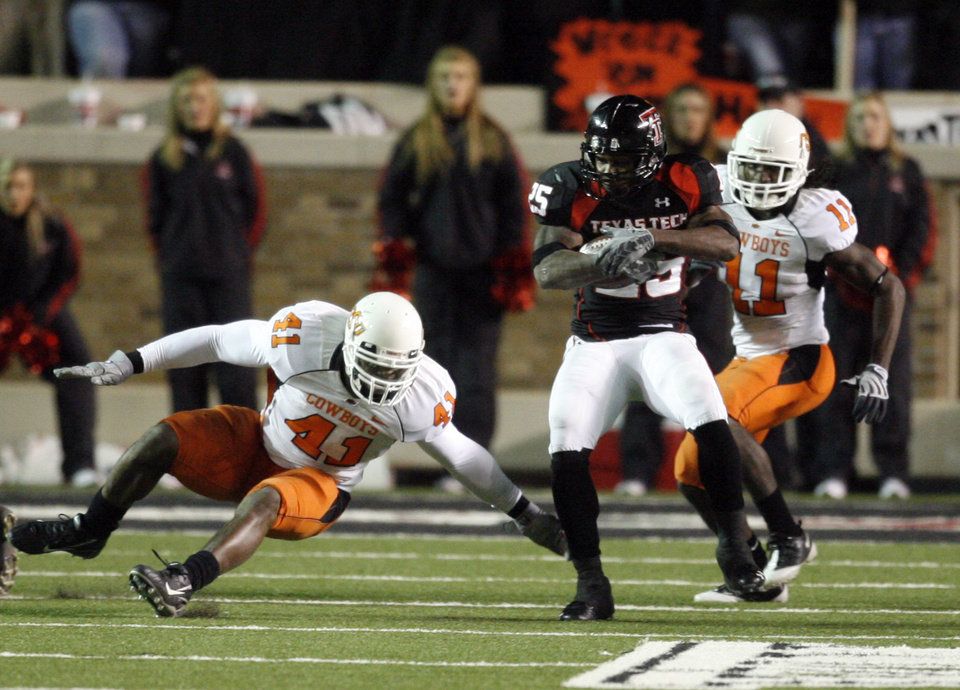 Photo - Baron Batch (25) catches a pass in front of Oeir Lemon (41), and T. J. Bell (11) during the second half of the college football game between the Oklahoma State University Cowboys (OSU) and the Texas Tech Red Raiders at Jones AT&T Stadium on Saturday, Nov. 8, 2008, in Lubbock, Tex.  Texas tech won 56-20.By Steve Sisney/The Oklahoman